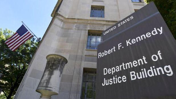 图为美国司法部外景。(美联社)