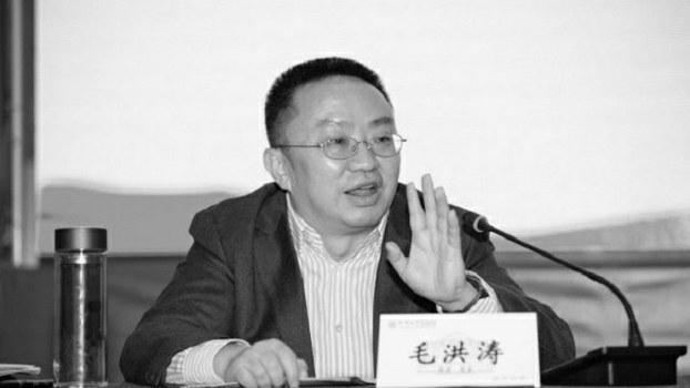 成都大学党委书记毛洪涛。(public domain)