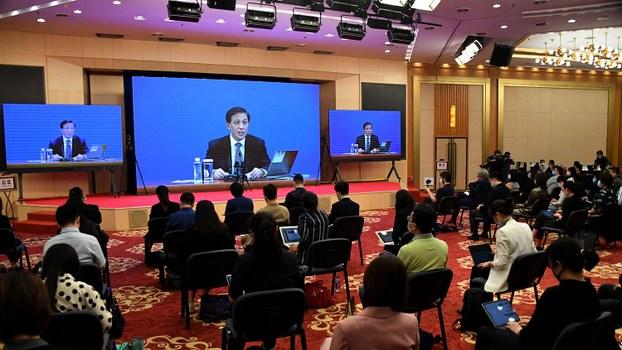 2020年5月21日,全国人大举行预备会议通过大会议程。发言人张业遂晚上在记者会上宣布,周五召开的全国人大会议将审议有关《建立健全香港特别行政区维护国家安全的法律制度和执行机制决定(草案)。(法新社)