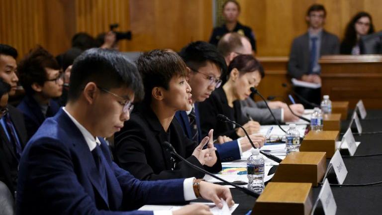 2019年9月17日,来自香港的黄之锋、何韵诗等人在美国国会作证。(法新社)