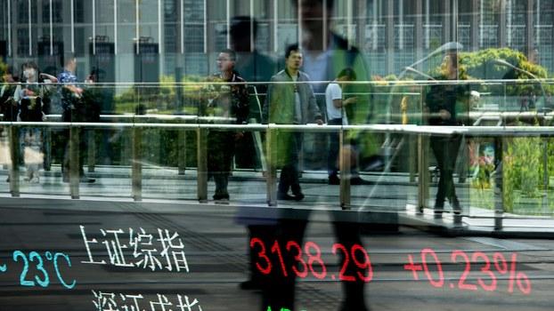 2019年6月24日,中国官方公开支持公务员投资证券市场。(资料图/美联社)