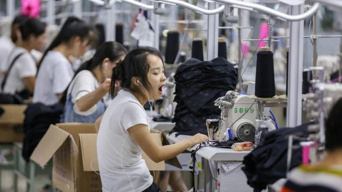 最近一年,中国国有企业正在逐步扩大规模,而民营企业则在走下坡路。(资料图/法新社)