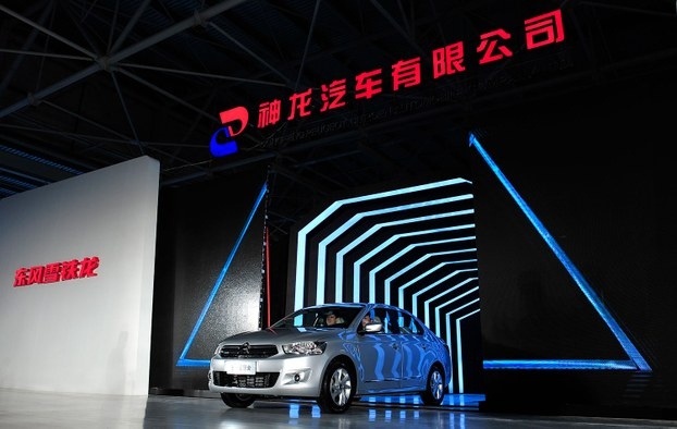 中国与法国合资企业,神龙汽车将在今年底之前裁员5500人。(法新社)