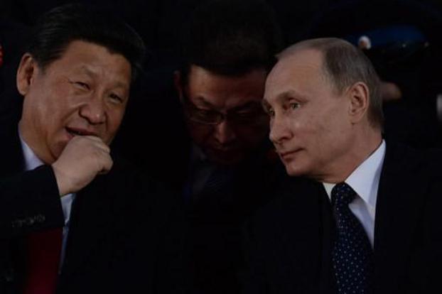 图片:习近平(左)、普京(右)。(AFP)
