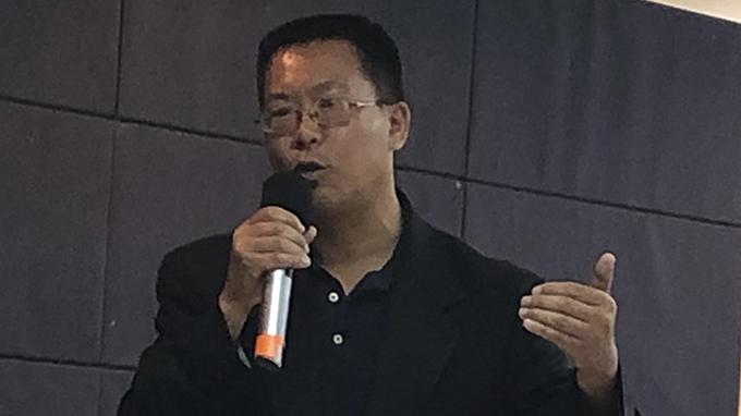 现居美国的中国维权律师滕彪(美联社)