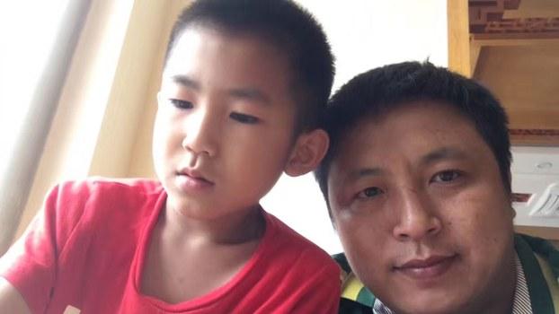 陈建刚与儿子/陈建刚提供