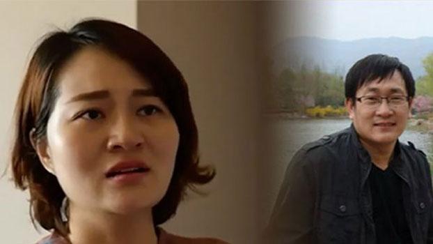 王全璋律师(右)与妻子李文足。(资料图片)