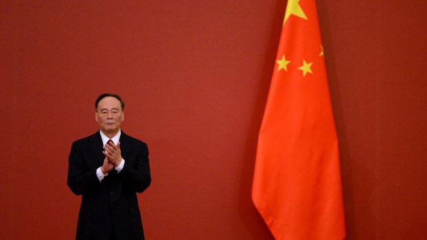 资料图片:中共中央政治局常委王歧山。(AFP)