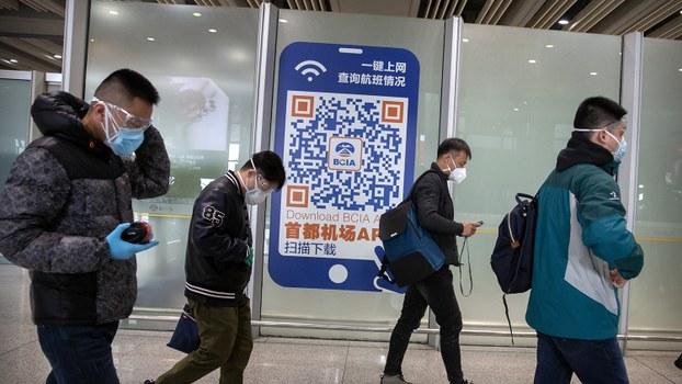 中国的新冠病毒疫情正在全球蔓延(美联社)