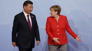 德国总理默克尔(右)和中国国家主席习近平。(美联社)